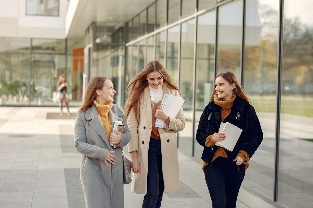students walking along building