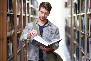 student in library with book
